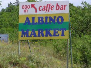Sign for Albino market. [Croatia].