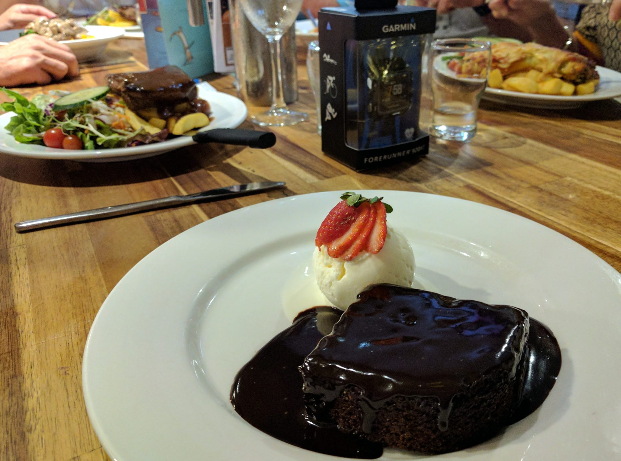 Steak, steak, pasta, schnitzel, steak, mud cake. Those are our orders.